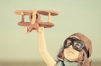 Kid traveling plane